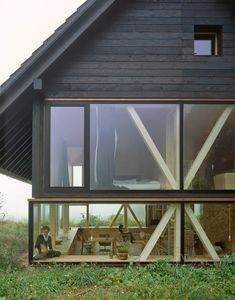 "cubebreaker: ""Zurich-based architect Pascal Flammer designed this timber house in Balsthal, Switzerland, which is sunken with ground-level wrap around windows, connecting it with nature. Design Exterior, Interior And Exterior, Exterior Siding, Interior Ideas, Timber House, Future House, Interior Architecture, Windows Architecture, Beautiful Architecture"
