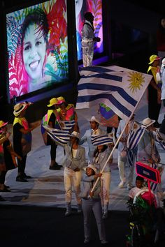 #RIO2016 Flag bearer Dolores Moreira Fraschini of Uruguay leads the team entering the stadium during the Opening Ceremony of the Rio 2016 Olympic Games at...