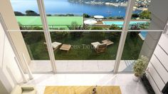 Contemporary Villa - View From Living Area Mezzanine Across Garden Terrace, Pool,  Tennis Court and Sea View