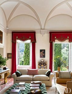 The room's curtains are of a Claremont silk, while the pelmets are made of antique fabrics   archdigest.com