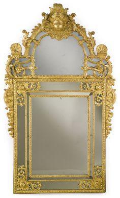 A Régence carved giltwood mirror circa 1715 - Dim: height 62.5 in.; width 37 in. (159 cm; 94 cm)