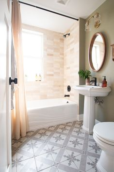 Our first floor bathroom is officially done and I'm in love with the cream Cloe tile we used in the shower. It looks sleek, organic, and perfect! Come take a look at this bathroom makeover. #bathroom #cloetile #showertile House, Bookshelves Diy, Bathroom Makeover, Install Backsplash, Fixer Upper, Bedroom Built Ins, Extra Long Shower Curtain, Bathroom Shower, Diy Wood Wall