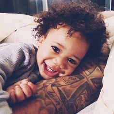 Love his hair, and love his tattoos.. :) interracialeroticabooks.com #interracialbabies #mixedbabies #mulattobaby