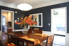 Love this room's color combination (navy, crisp white and warm wood) navy dining and beyond