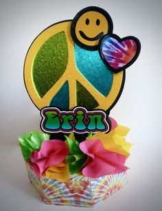 Peace signs, tie dye, love & smiley faces were the action pieces on this centerpiece with a Sixties flair.