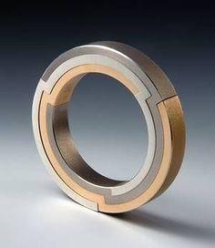 futuristic accessories, gold, silver, jewelry, cyberpunk jewelry, industrial jewelry by FuturisticNews.com