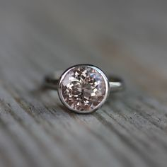 10mm MORGANITE Ring and 14k Rose Gold Solitaire Ring. $1,348.00, via Etsy.