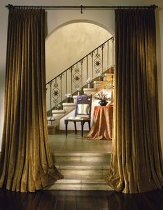 Classic Mediterranean details: the iron banister and rich velvet drapery.