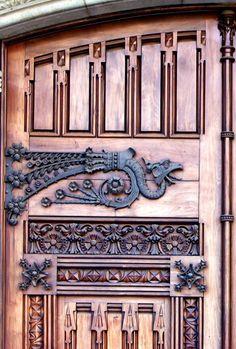 Barcelona - decorative hinge, and carved wood door.
