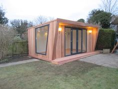 5x3m Pinnacle garden room with cedar cladding, 3m graphite French door combi & angled feature window, from £16,495 (inc. VAT)
