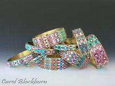 Brass bangles with Rorschach pattern. Patterns in Polymer workshop
