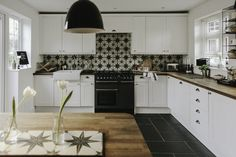 A budget makeover for a classic kitchen with white units and oak worktops