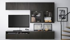 IKEA BESTÅ is a versatile, multipurpose living room storage system, suitable for your TV and other electronic devices. Assemble your own version or choose one of our combinations, like this black/brown set of cabinets with drawers, doors and glass doors. Corner Entertainment Unit, Home Entertainment Furniture, Entertainment Center Decor, Ikea Tv, Ikea Wall, Media Furniture, Ikea Furniture, Tv Storage, Storage Ideas