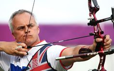 London 2012 Olympics: in pictures July 27 - On target: Simon Terry of Great Britain prepares to arch during the archery ranking round on Olympics opening day  Picture: GETTY IMAGES