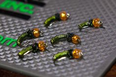 Neon Greenie beadheads with a lime green wire rib and peacock herl thorax (On The Vise)