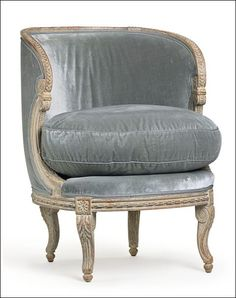 Soothing and soft silver/grey fabric and aged patina. Love this chair.: