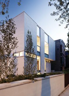 Studio Dwell's Bucktown Three, a custom home in Chicago, presents a reserved facade to the street.