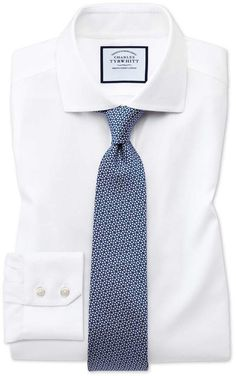 "Extra Slim Fit Spread Collar Non-Iron Cotton Stretch Oxford White Dress Shirt Single Cuff Size 15.5/33 by Charles Tyrwhitt. ""For those of us who work out, something I can now say with a semi-straight face after 2017's mammoth bike ride, slimmer cut shirts like these can be very flattering indeed. They have an lovely natural stretch to keep you comfortable, and our non-iron finish to put a big cheesy grin on your face."""