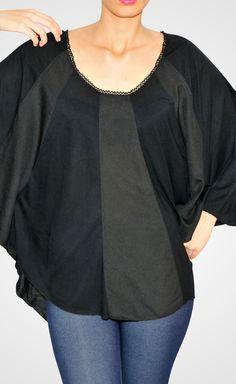 Top poncho negro, $114,000