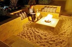 A mini beach as a backyard fire pit! | step down into sand, surrounded by grass level.