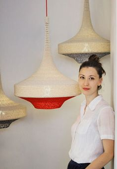 Designer Naomi Paul with pieces from her OMI pendant collection
