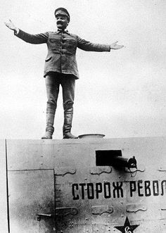 Leon Trotsky, commander of the Red Army, gives a speech atop a tank during the Russian Civil War