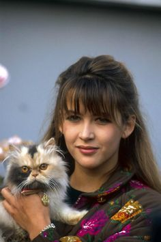 Sophie Marceau In 1991, the French actress campaigned against the abandonment of cats and dogs. Here, she's visiting the Society for the Protection of Animals shelter in Genevilliers, France.