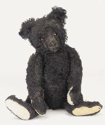 Rare Titanic Black Mourning Bear By Steiff.  The bear was one of only 600 which were made especially for the British market in May 1912, to show empathy for the loss of the passengers of the R.M.S. Titanic.  It is said their eyes were rimmed red to appear as if they had been crying. They were also manufactured with a somber expression.  16in.
