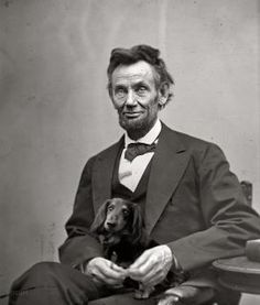 Mr. Lincoln and his dachshund.
