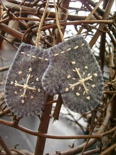 Mittens Ornaments :: This style is one of my favorites so far, & I have lots of grey felt & felted sweaters!