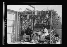 Picture a Day: Sukkot (Tabernacles) Holiday in Jerusalem 100 Years Ago This is a family in 1939 in Jerusalem in thier Sukkah