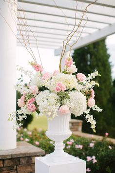 Dimensional, soft urn arrangement for ceremony- roses, hydrangea and other premium accent flowers