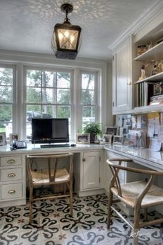 Built-in counter-style workspace and cabinetry - the white paint and picture window make this space light and bright!