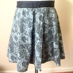 H&M Blue Denim Rose Print Hight Waist Skater Skirt H&M Blue Denim Rose Print Skirt | Leather like waist band | small unnoticeable wear by zipper as shown in pic of back H&M Skirts Mini
