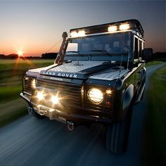 Land Rover Defender 110 Td5 Sw County on road with light bar