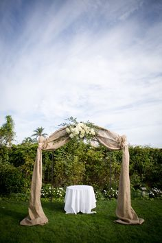 Wedding Arch, Burlap, Hydrangea. Maybe different fabric and flowers.