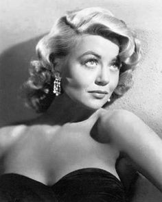 Dorothy Malone, 1956, a publicity shot for for the Douglas Sirk picture Written on the Wind, for which she won an Oscar