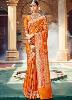 Rich look attire to give your a right choice for any party or function. Look ethnic in this affluent orange art silk designer saree. The ethnic weaving work on the attire adds a sign of beauty statement to your look. Comes with matching blouse. Art Silk Sarees, Banarasi Sarees, Beau Sari, Orange Saree, Orange Blouse, Bollywood, Trendy Sarees, Orange Fabric, Orange Color