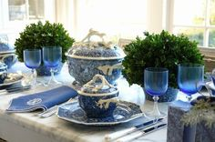 Blue-tinted glassware draws the eye toward these cute mini topiaries.  See more from Carolyne Roehm »   - HouseBeautiful.com