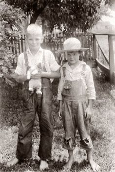 """""""Tom and Huck circa 1932.""""  Call it whatever you want, but two young boys and a cat in the summertime...doesn't get more nostalgic than that."""