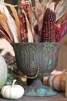 i've got a few of these metal urns sitting around that need to be painted.  this is a great look for fall.  perfect.