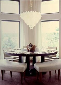 Open Plan Dining Room Located Beside A Large Kitchen Features A Round  Salvaged Wood Dining Table Surrounded By Gray Bamboo Dining Chairs With  Whiteu2026