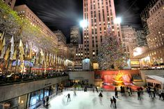 Rockefeller Center, NYC    Rockefeller Center is a complex of 19 commercial buildings covering 22 acres (89,000 m2) between 48th and 51st streets in New York City, United States. Built by the Rockefeller family, it is located in the center of Midtown Manhattan, spanning the area between Fifth Avenue and Sixth Avenue. It was declared a National Historic Landmark in 1987.