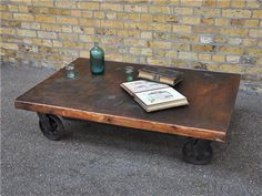 Coffee Table, maybe with longer dark-iron legs between wood and wheels