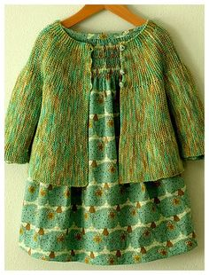 Green on green cuteness – loving this handknit sweater.