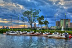 Boats parked for the night along the dock of Community Boating as the clouds rush in to cover up a pretty amazing and colorful but short sunset leaving a stormy, bluish to the landscape.