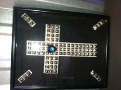 """8X10"""" studded rock star framed cross.  Made from upcycled studded belt.  Great for that musician.  Added pick and rhinestone.  Made for my sons new apt."""