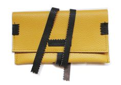 yellow leather tobacco pouch