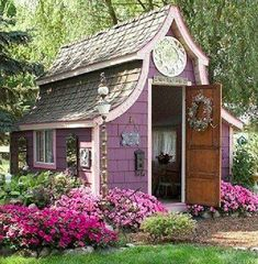 tiny purple cottage/shed/craft room. very very inspiring space; could do lots of creating there!!!