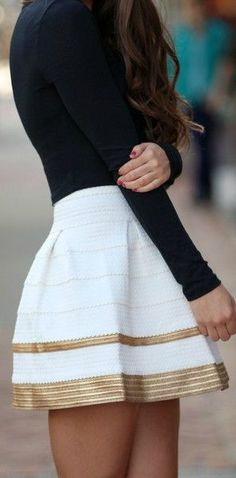 Gold trim skirt and black sweater